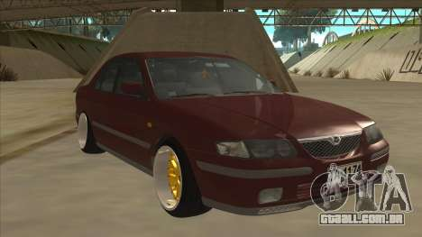 Mazda 626 Hellaflush para GTA San Andreas esquerda vista